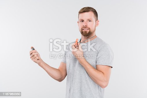 1045886560 istock photo Bearded young sports trainer or referee with whistle looking at you 1187980350