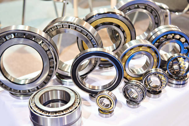 Bearings of different sizes in exhibition Bearings of different sizes in the showcase of the exhibition ball bearing stock pictures, royalty-free photos & images
