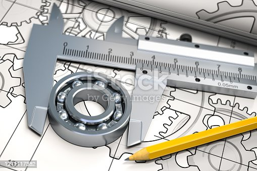 istock Bearings with trammel and pencil on technical drawing. Engineering, industrial and production concept. 1211117382