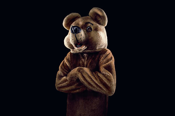 bearness a young honey bear postin mascot stock pictures, royalty-free photos & images