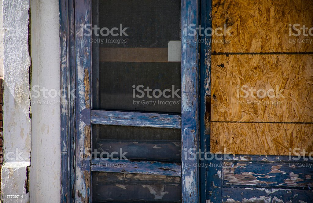 Beaten pealing Paint chipping Rustic Broken Down Building stock photo