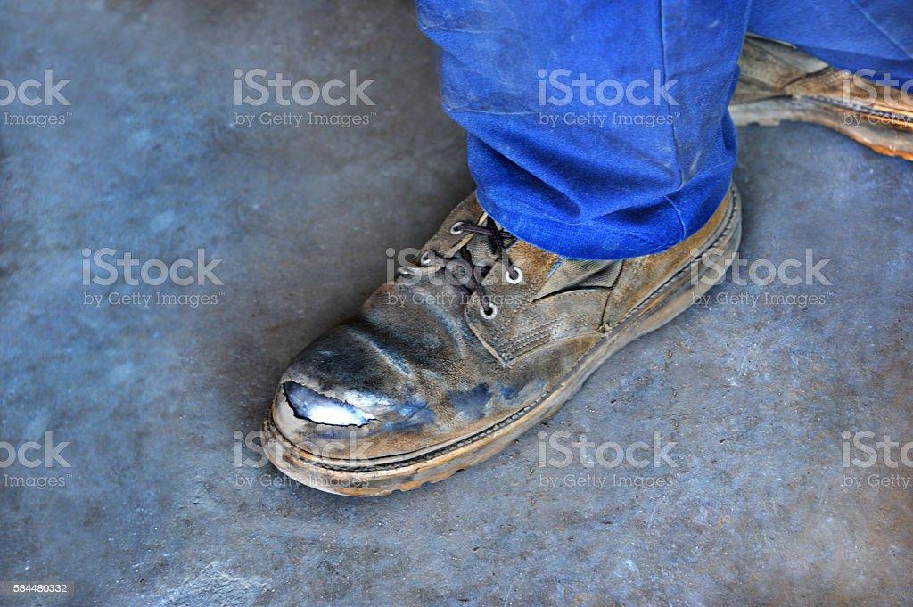 Beaten Up Pair of Boots stock photo