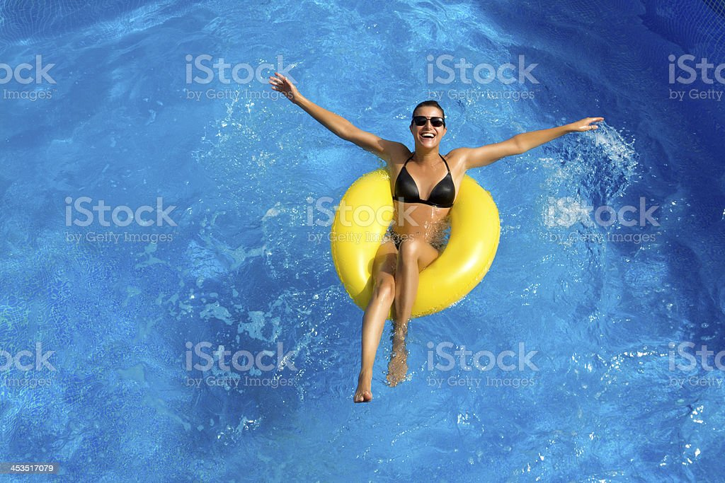 Beatiful Brunette Playing in the Pool stock photo