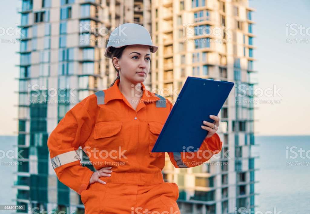 beatiful business woman engineer wearing orange coverall - Royalty-free Adult Stock Photo