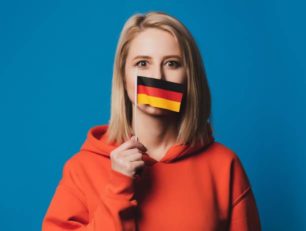 beatiful girl holds flag of Germany stock photo