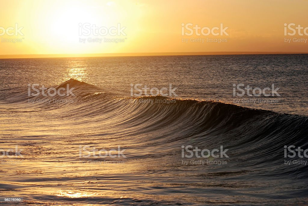 beatiful sunset with splashing waves in front royalty-free stock photo