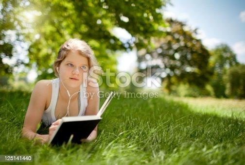 623358818 istock photo Beatiful Teenage Girl in the Park 125141440