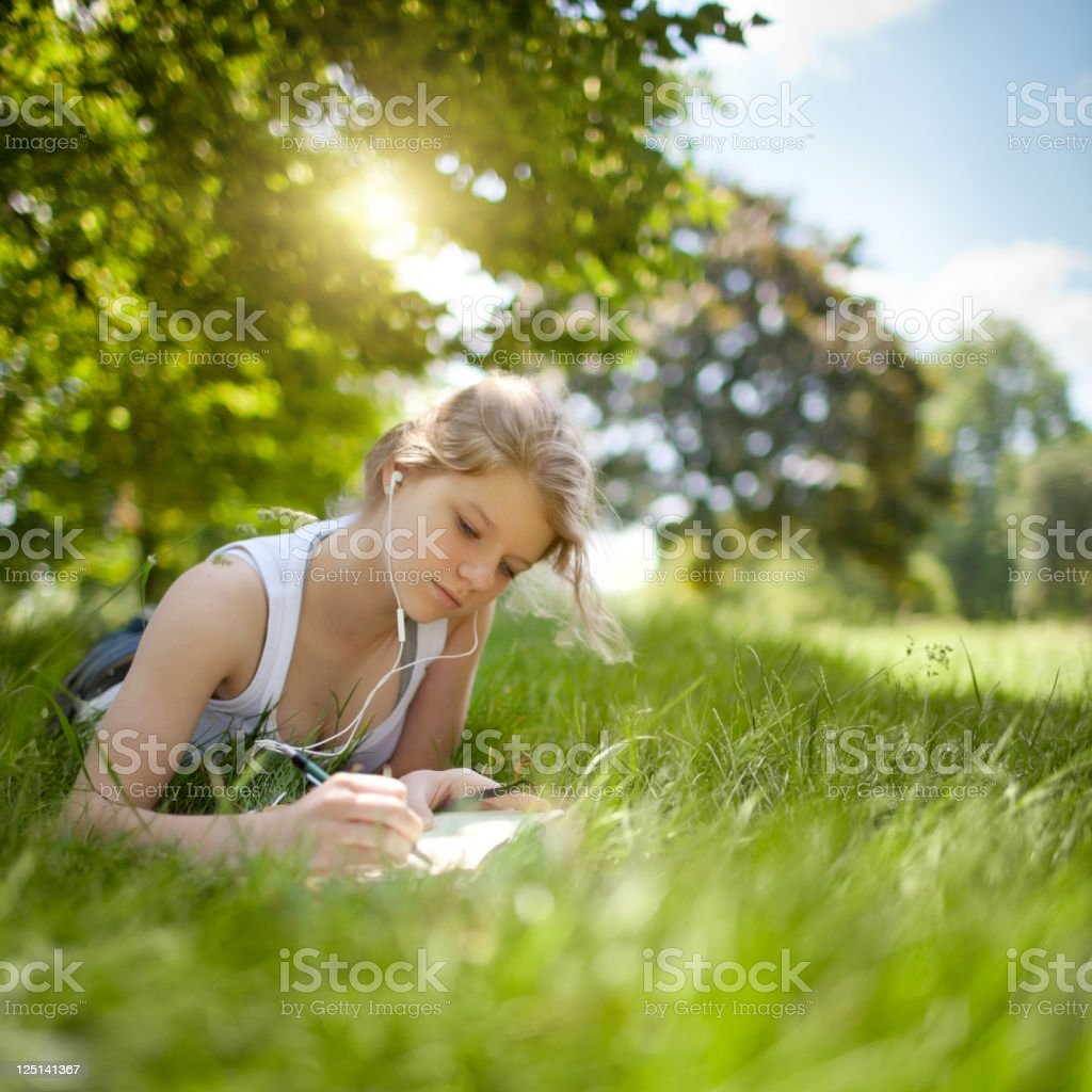 Beatiful Teenage Girl Studying in the Park stock photo
