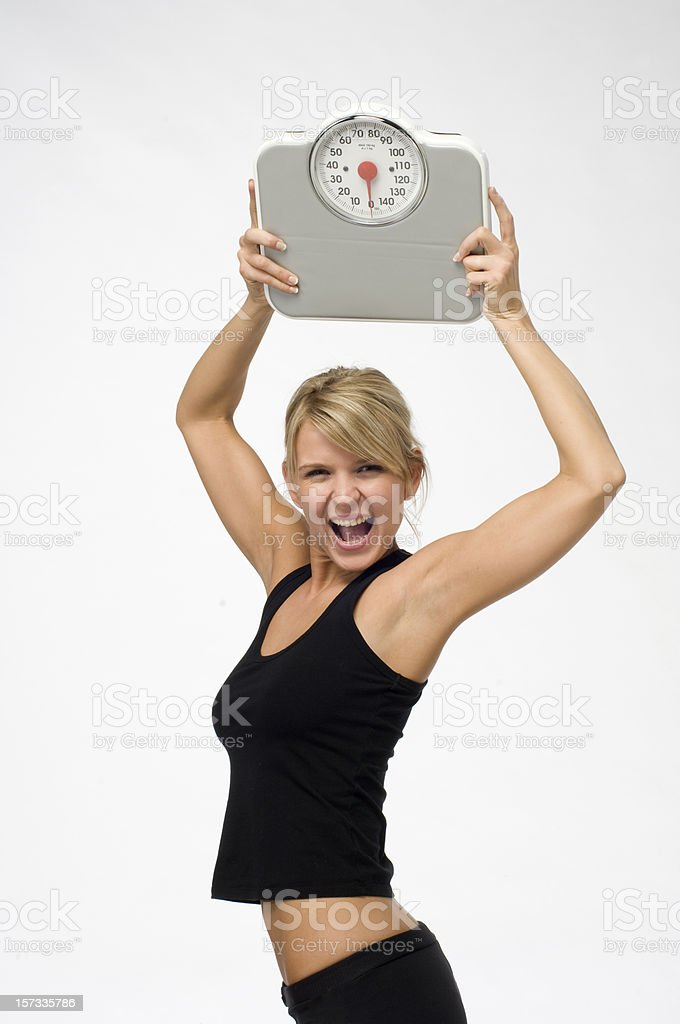 beating the weight scale royalty-free stock photo