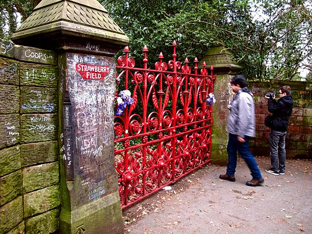 Beatles fans at Strawberry Field gates in Liverpool stock photo