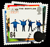 'Exeter, United Kingdom - March 07, 2010: British Postage Stamp showing the Help Album Cover showing the Four Members of the Beatles Pop Group, circa 2007'
