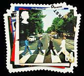'Exeter, United Kingdom - March 07, 2010: British Postage Stamp showing the Abbey Road Album Cover from the Beatles Pop Group, circa 2007'