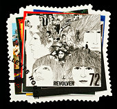 'Exeter, United Kingdom - March 07, 2010: British Postage Stamp showing the Revolver Album Cover from the Beatles Pop Group, circa 2007'