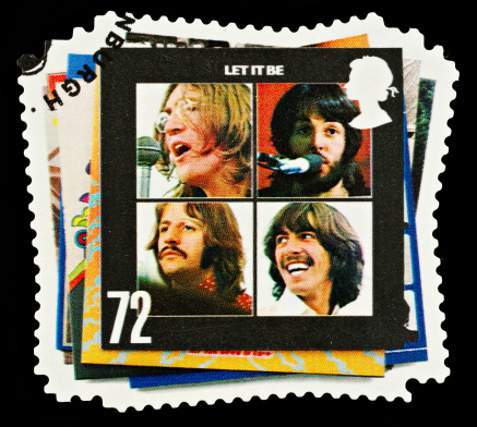 Exeter, United Kingdom - March 07, 2010: British Postage Stamp showing The Let It Be Album Cover showing the Four Members of the Beatles Pop Group, circa 2007
