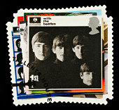 Exeter, United Kingdom - March 07, 2010: British Postage Stamp showing The With The Beatles Album Cover showing the Four Members of the Beatles Pop Group, circa 2007