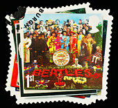 'Exeter, United Kingdom - March 07, 2010: British Postage Stamp showing the Sergeant Peppers Lonely Hearts Club Band Beatles Album Cover, circa 2007'