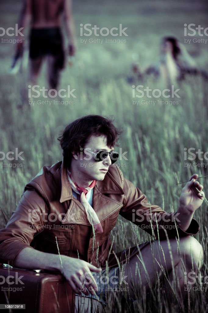 Beatnick hipsters in a field royalty-free stock photo