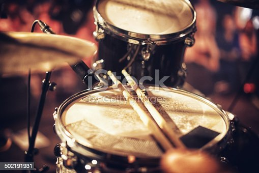 Drum kit set up on a stage with a crowd in the backgroundhttp://195.154.178.81/DATA/i_collage/pi/shoots/782610.jpg
