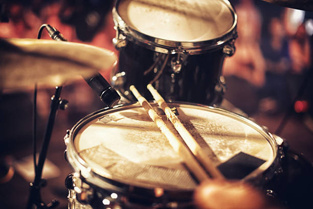 Beats waiting to happen Drum kit set up on a stage with a crowd in the backgroundhttp://195.154.178.81/DATA/i_collage/pi/shoots/782610.jpg cymbal stock pictures, royalty-free photos & images