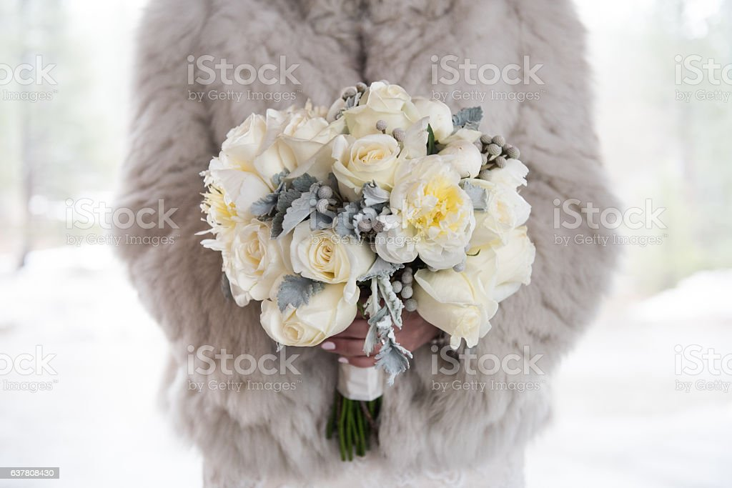 Beauitufl bouquet in the hands of bride stock photo