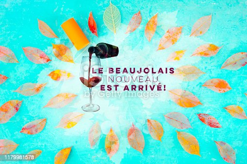 istock Beaujolais Nouveau poster design. The new wine has arrived. With watercolor glass and bottle, autumn leaves and typography, with a place for text and logo 1179981578