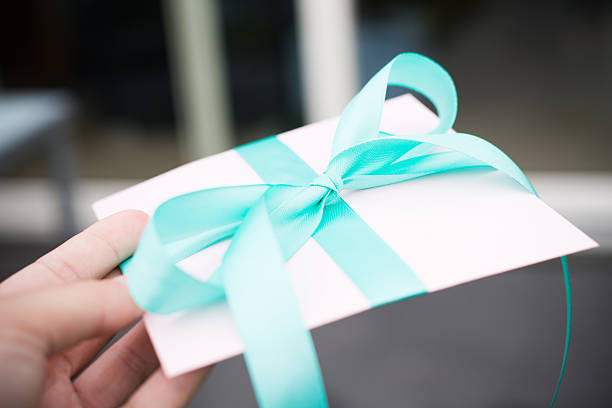 beautfully wrapped gift - enevelope - gift voucher or card stock photos and pictures