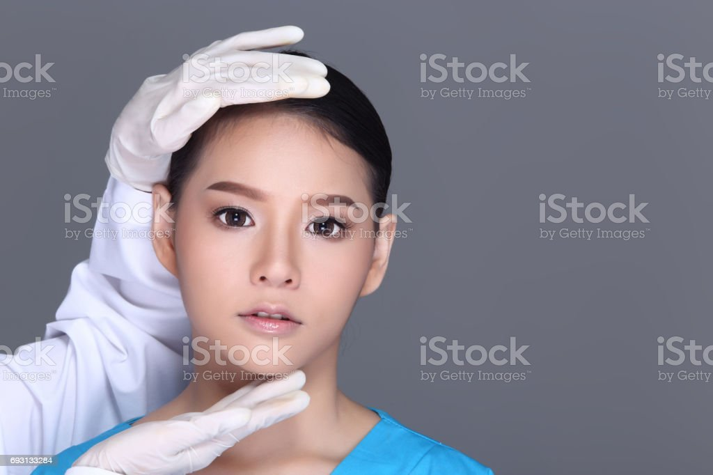 Beautician Doctor Check Diagnose Face structure patient before plastic surgery stock photo
