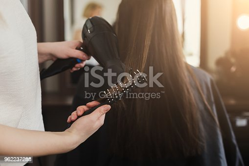 istock Beautician drying woman's hair 962237288