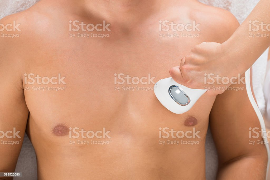 Beautician Giving Laser Epilation On Man's Chest – Foto