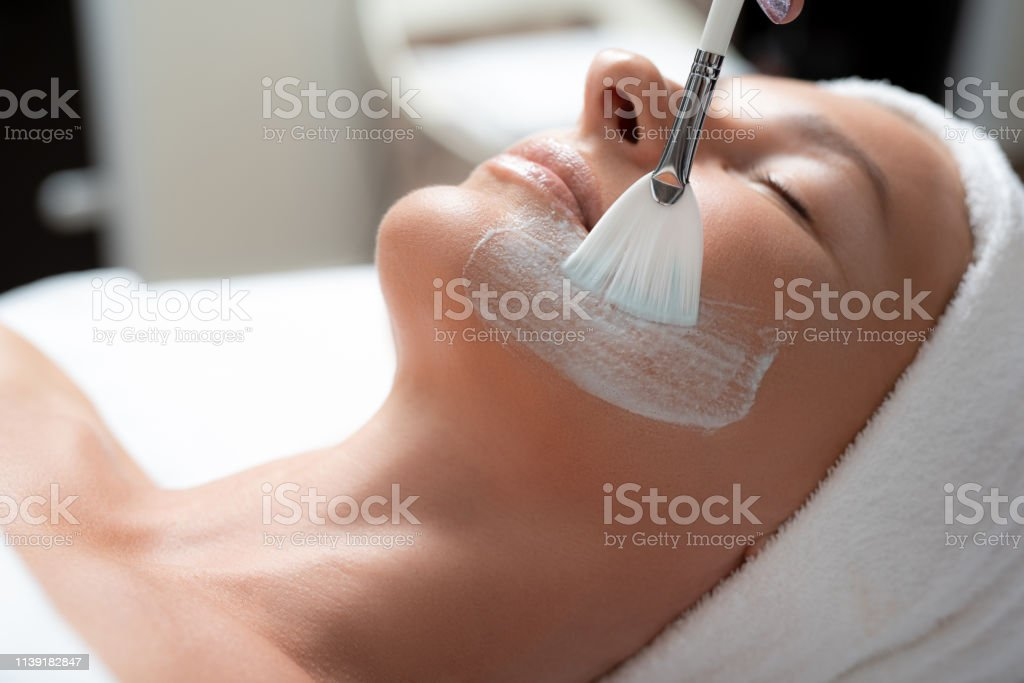 Relaxing at spa. Close up portrait of beautiful middle aged woman...