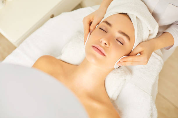 Beautician makes cleansing facial skin girl. stock photo