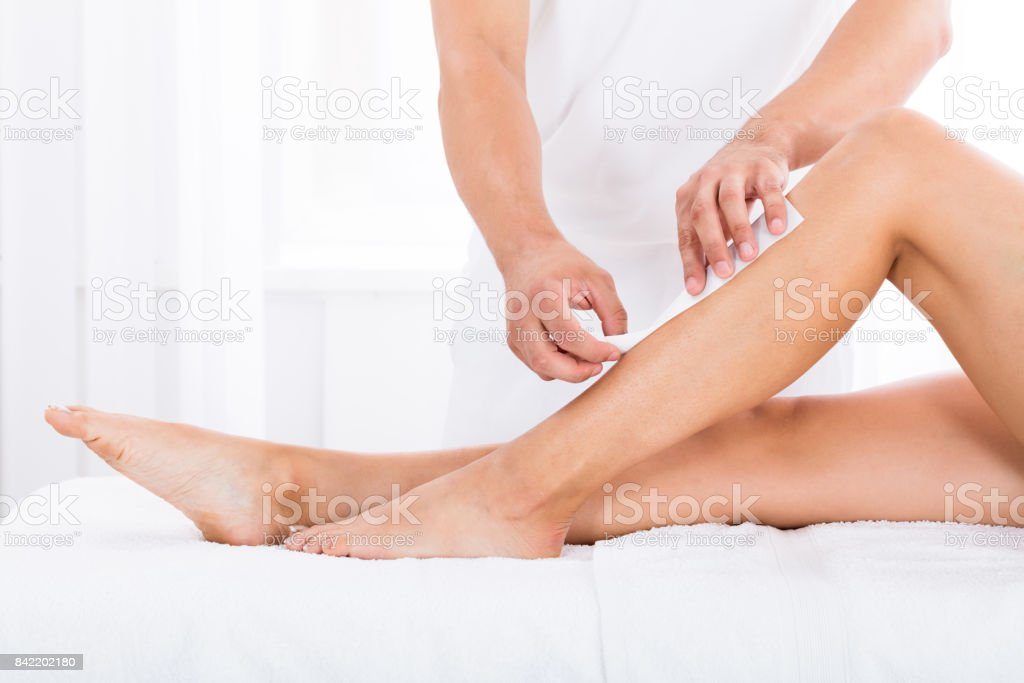 Beautician Waxing Woman's Leg stock photo