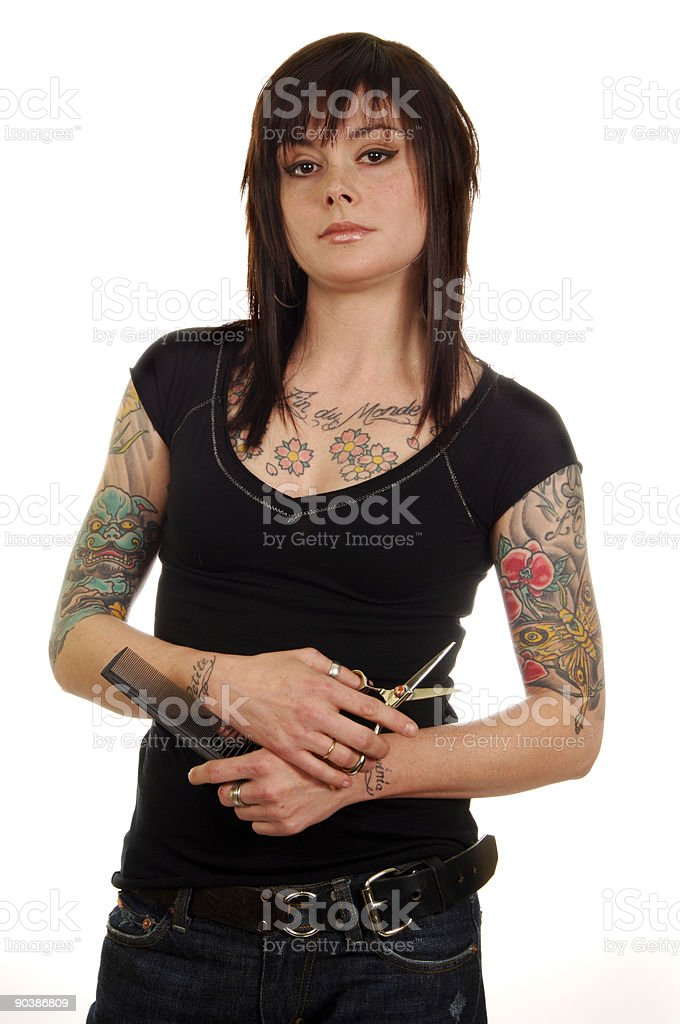 Beautician with tattoos,scissors,and comb royalty-free stock photo