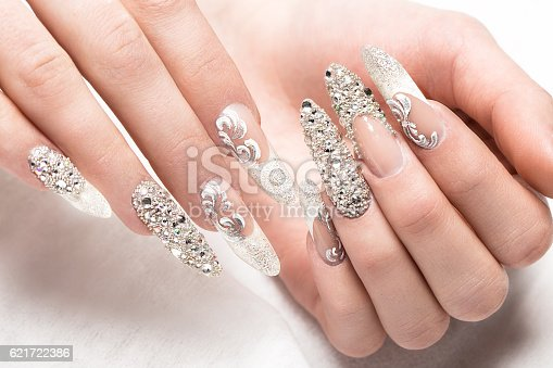 istock Beautifil wedding manicure for the bride in gentle tones with 621722386