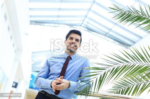 825082848istockphoto Beautifu businessman in modern workplace 1035963724