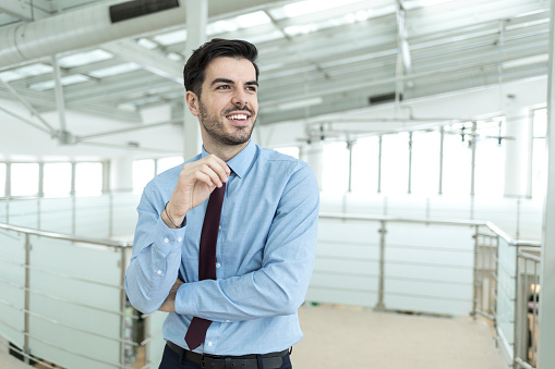 825082848 istock photo Beautifu businessman in modern workplace 940031220