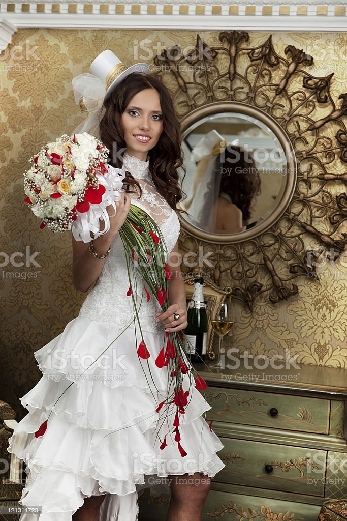 Beautifu fancyl bride with bouquet in the luxury interior. royalty-free stock photo