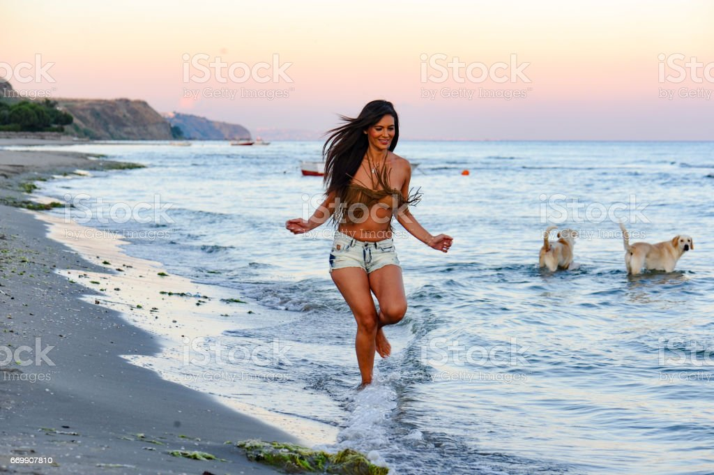 Beautifu woman running on the beach stock photo