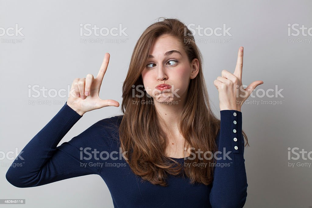 beautiful 20s girl enjoying a LOL with a funny face stock photo