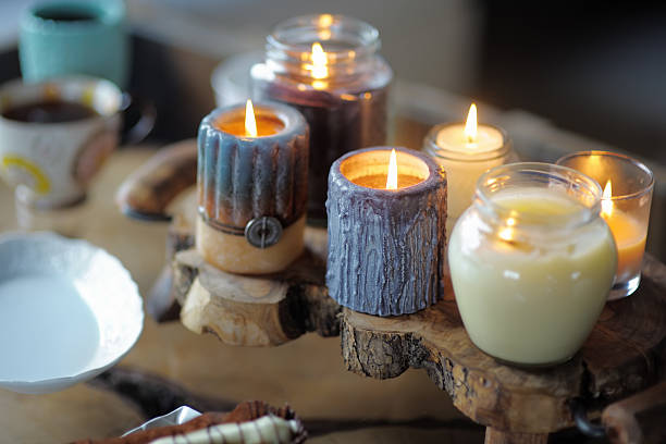 Beautiful ablaze candle Beautiful ablaze candle on the wooden table ablaze stock pictures, royalty-free photos & images