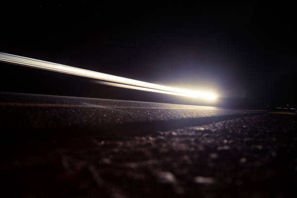 Beautiful, abstract car lights on a country road. TRaffic in the night, looking from a roadside. stock photo