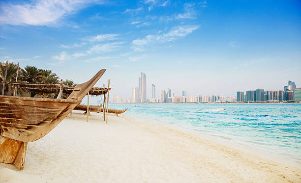 beautiful abu dhabi beach - abu dhabi stok fotoğraflar ve resimler