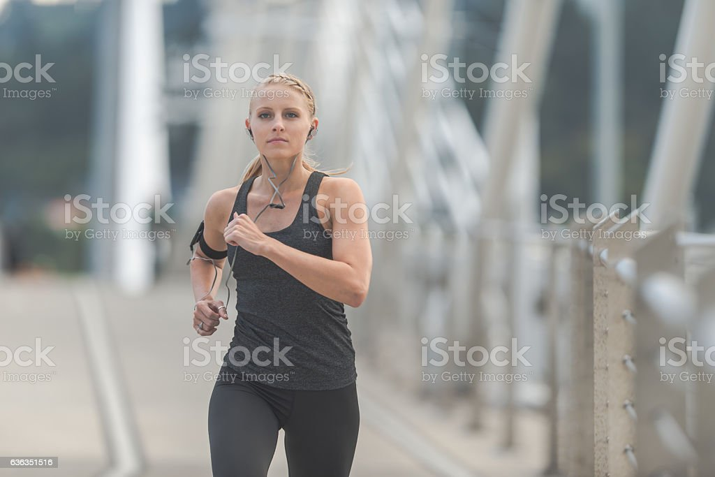 Beautiful adult female running out in the city stock photo