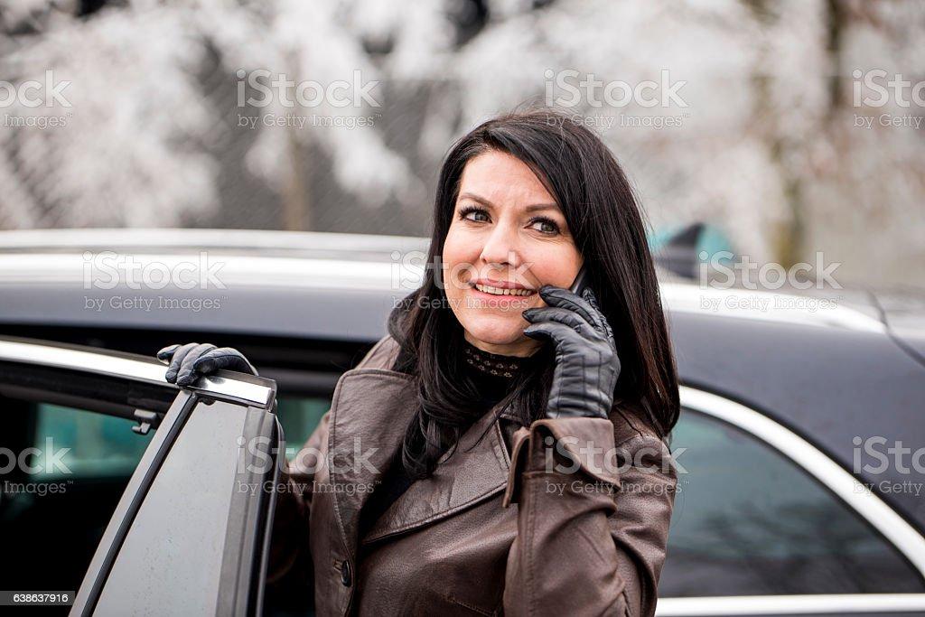 Beautiful adult woman talking on the phone stock photo