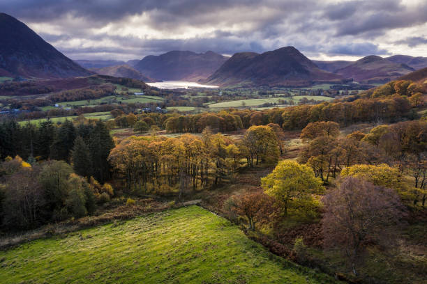 Beautiful aerial drone Autumn Fall landscape image of view from Low Fell in Lake District looking towards Crummock Water and Mellbreak and Grasmoor peaks stock photo