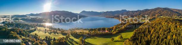 Photo of Beautiful Aerial Flight at the Tegernsee Lake in Bavaria Germany. Perfect autumn sunset with some fog in the forest