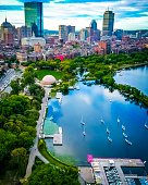 Aerial picture of the boats in the Charles River with Boston's elegant skyline in the background. The back bay lies quietly next to it