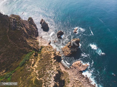 istock Beautiful aerial vibrant view of Capo Da Roca, the most western point of Europe, Portuguese municipality of Sintra, near Azoia, district of Lisbon, Serra de Sintra, Portugal, shot from drone 1046232102
