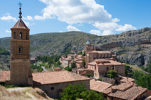 Beautiful aerial view of Albarracin, an ancient village of Teruel, seen from its fortress. Traditional buildings of stone, church, and mountains around. Spain, Europe