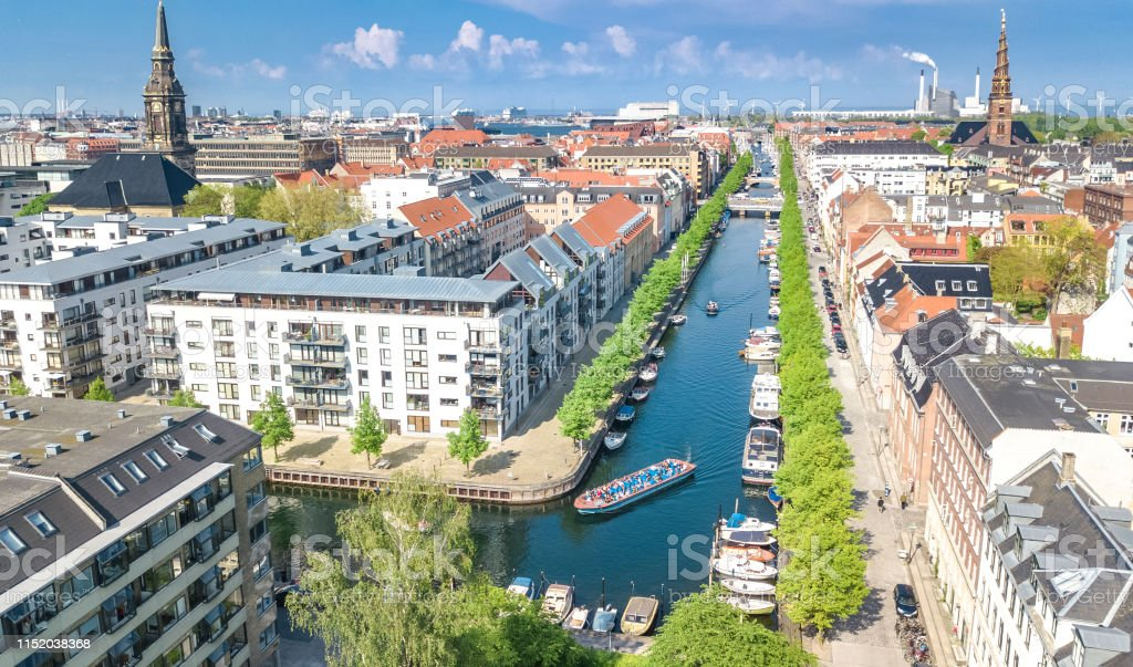 Beautiful aerial view of Copenhagen skyline from above, Nyhavn historical pier port and canal with color buildings and boats in the old town of Copenhagen, Denmark Beautiful aerial view of Copenhagen skyline from above, Nyhavn historical pier port and canal with color buildings and boats in the old town of Copenhagen, Denmark Above Stock Photo